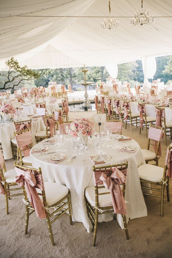 Blush Wedding Table Setting With A Lot Of Pink Roses