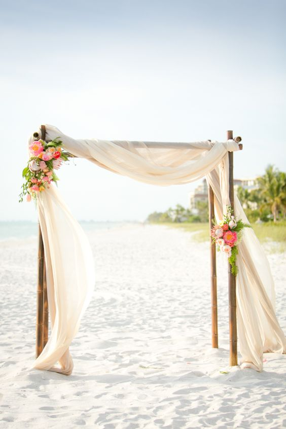 Wedding arbor with draped curtains and roses. Stunning and romantic!