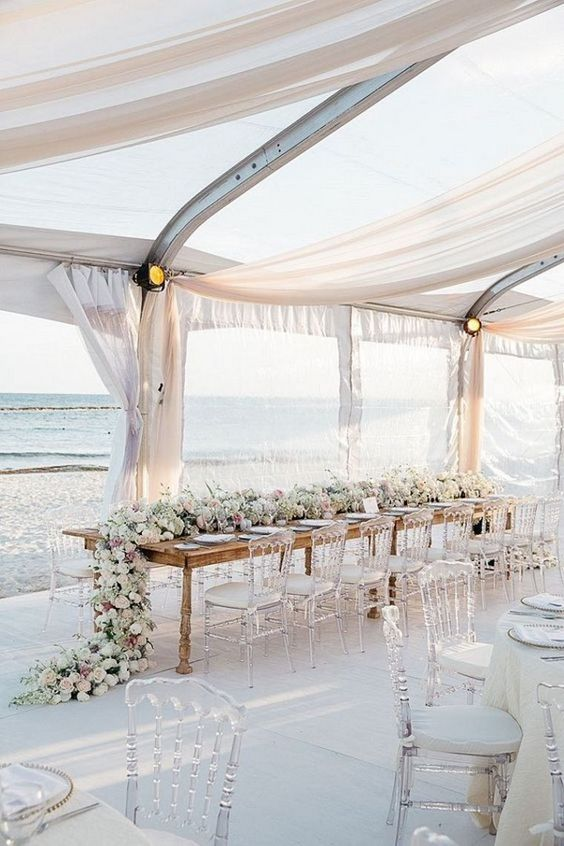 Flowers draped over a table. Perfect for a beach wedding.