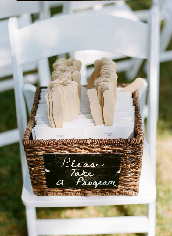 wedding programs on popsicle sticks. How cute! A playful detail for your beach wedding.
