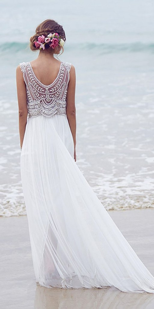 Wedding dress and hairstyle for a beach wedding.