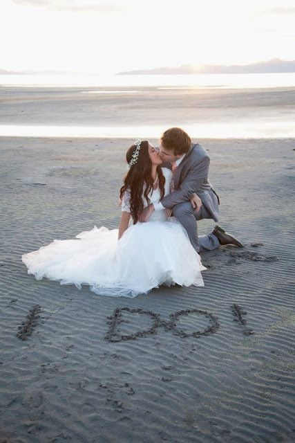 Beach wedding. Writing in the sand, very cool!