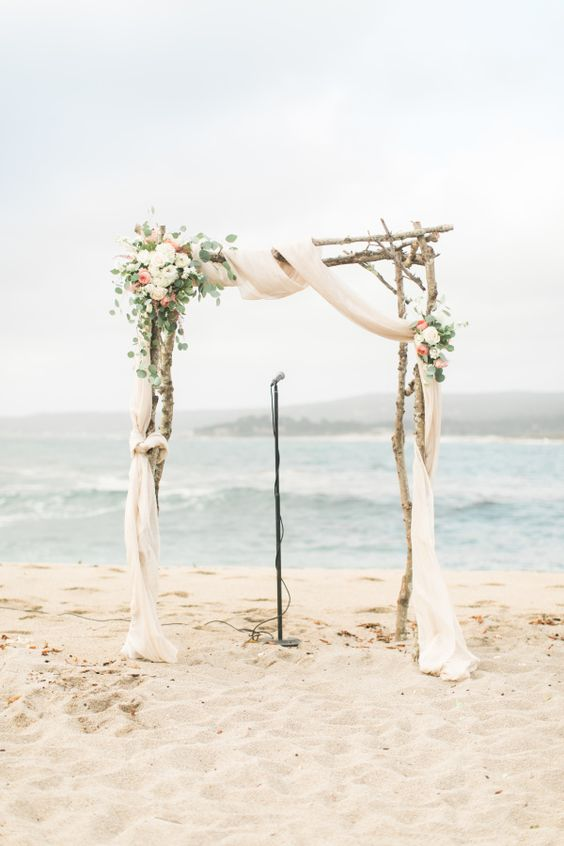Arbor with roses for a beach wedding.