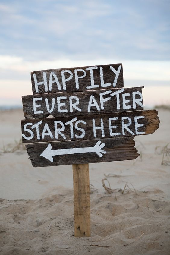 happily ever after sign for a beach wedding