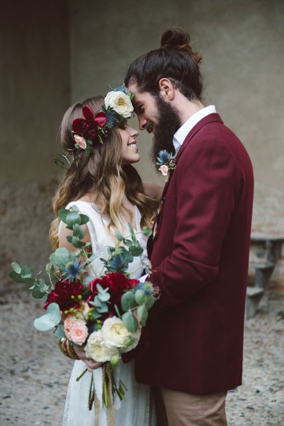 Bride and groom during a bohemian themed wedding. Stunning floral creations.