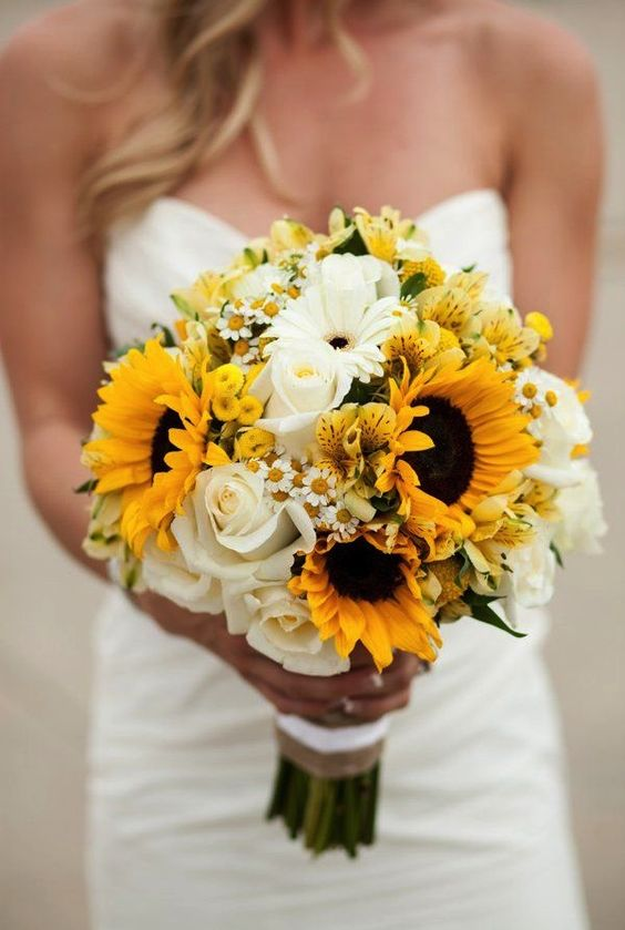 Summer bouquet with sunflowers, dasies and white roses!