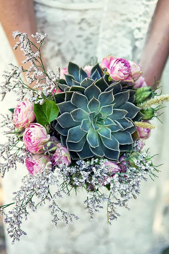 Roses and succulents are worlds apart, but they mix into a stunning piece of floral art.