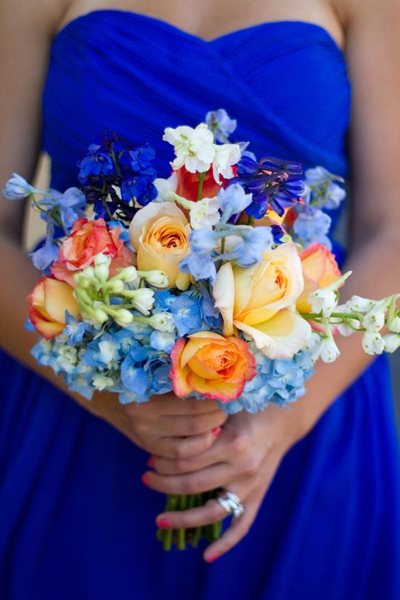 Coral colours in bouquets work extremely well for beach weddings.