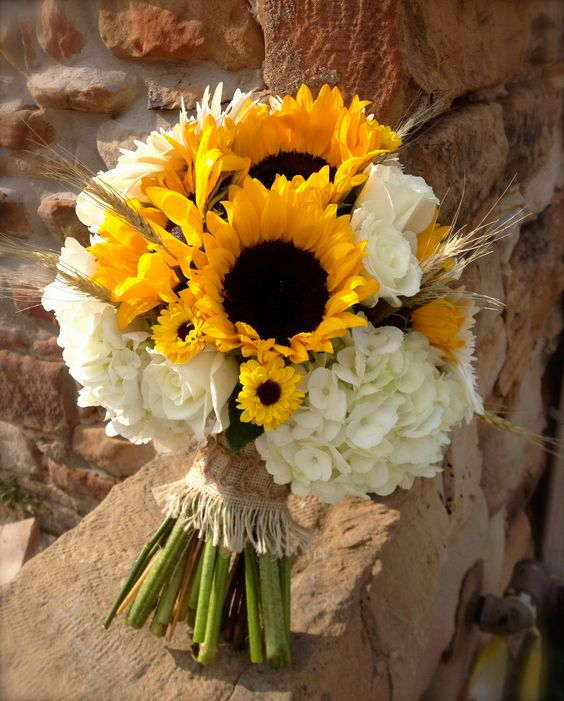 summer bouquet with sunflowers and white roses