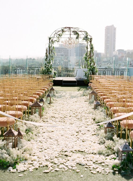 weddingtrend city wedding with rose petal aisle on a rooftop in the big city