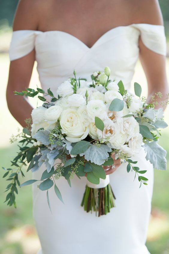 beautiful brides bouquet with roses for a white wedding