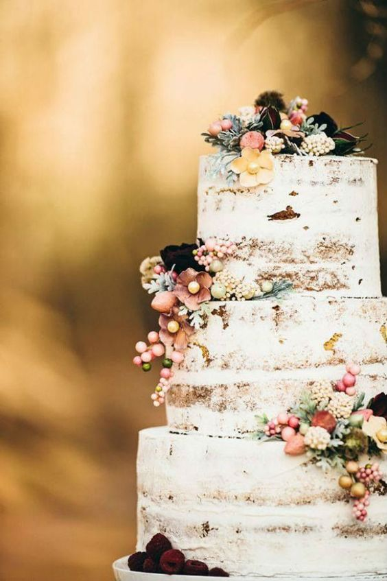 Slightly iced wedding cake. This one would be perfect for a bohemian wedding!