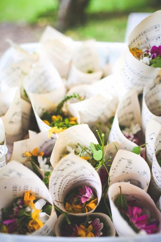 Throwing petals instead of rice. Lovely idea!