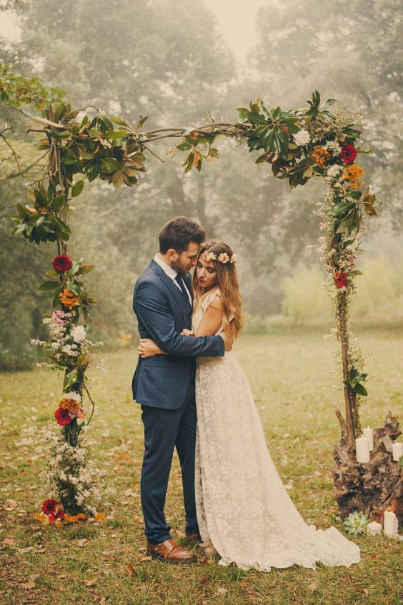 Amazing wedding arbor. Also love the laced dress!