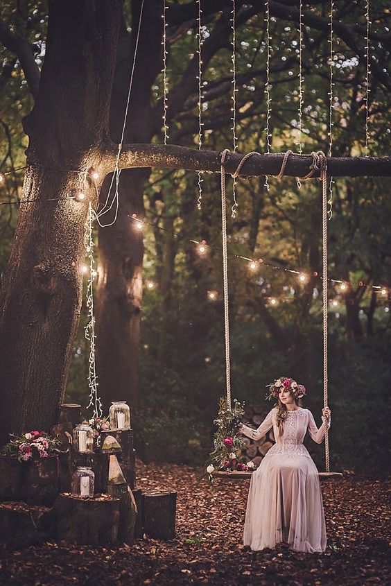 Bohemian wedding scenery. Love the swing and the lights!