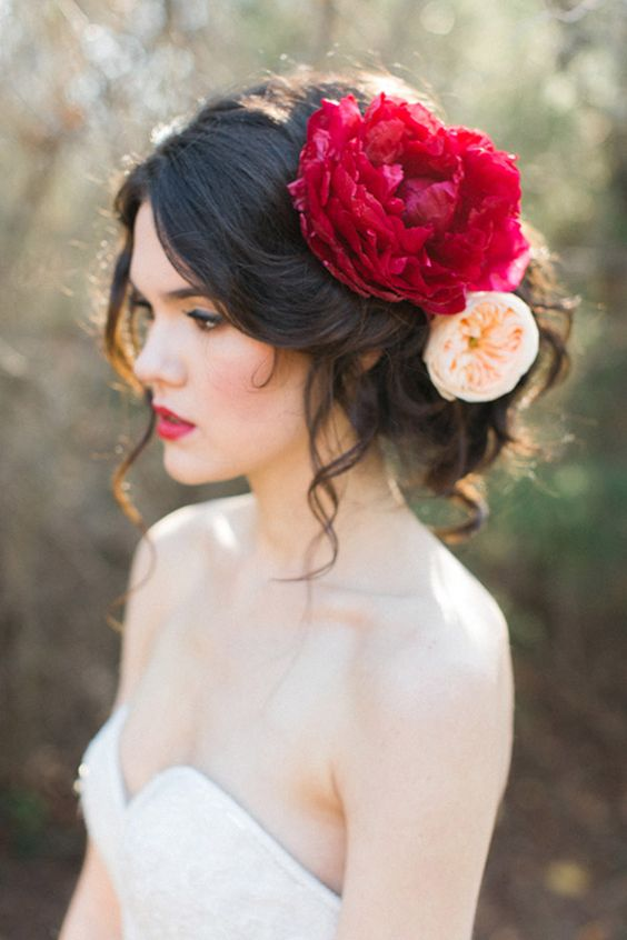Beautiful hairstyle combination with red and peach flowers.