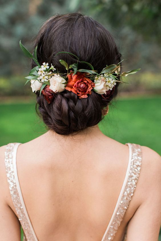Very elegant combination with the open back dress and this wedding hairstyle with roses.