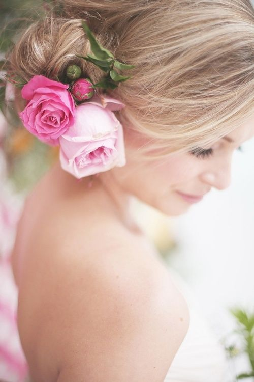 Easy but stylish wedding hairstyle. Peony roses would look great in this look.