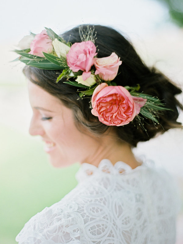 Loosely arranged wedding hairstyle with a big rose. Love it!