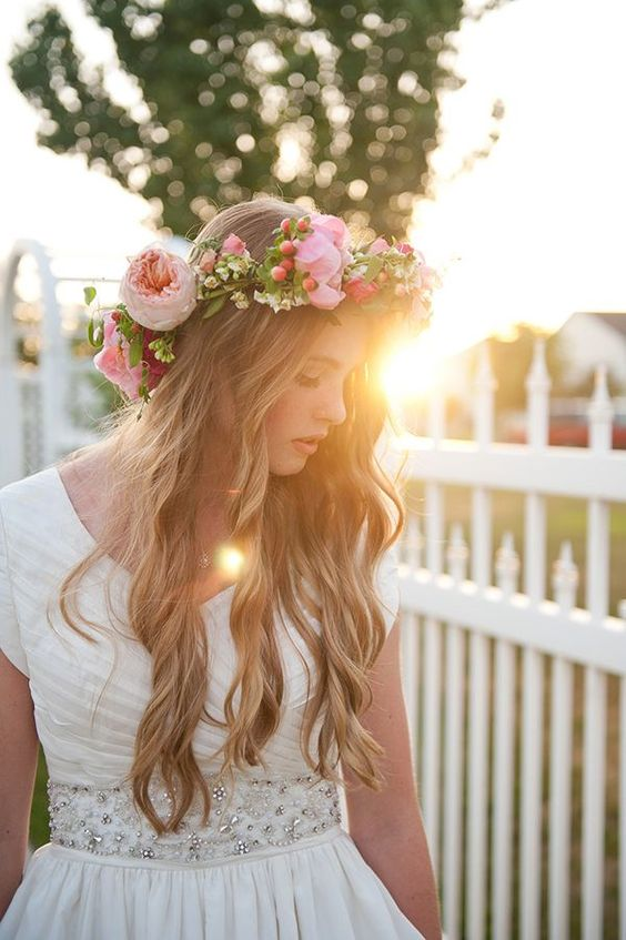 Bohemian wedding hairstyle with roses. Very romantic.