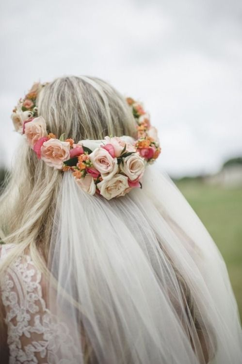 Beautiful flower crown. Love how the veil is attached to it. Gorgeous wedding hairstyle!