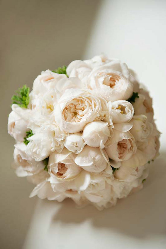 Beautiful bouquet featuring ivory David Austin roses, lisianthus and double tulips with a touch of green foliages.