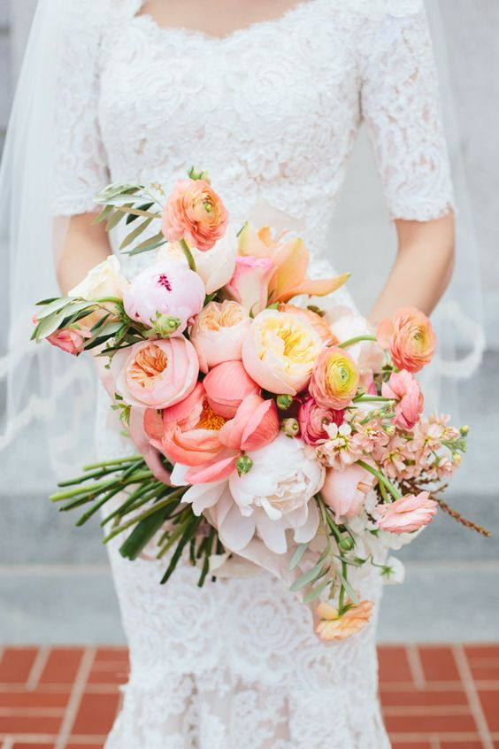 Juliet roses and pink peonies in a lovely spring/summer bouquet
