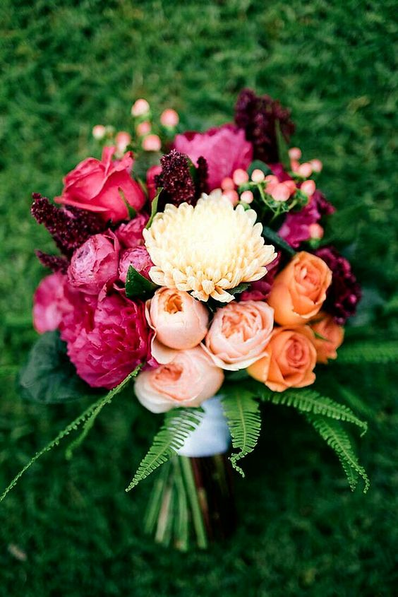 Peach Juliet David Austin English garden roses, pastel peach dahlias, orange roses, fuchsia peonies, hot pink roses, red amaranthus, coral hypericum berries & green sword fern.