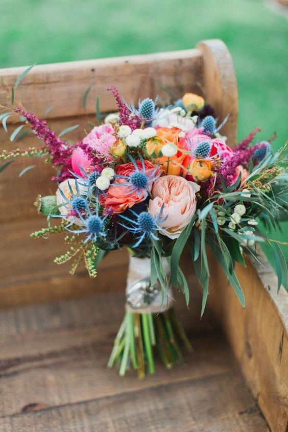 Colorful and wild with messy greens. This bouquet incorporated vibrant peonies, garden roses,thistles, ranunculus, roses, astilbes and dahlias.