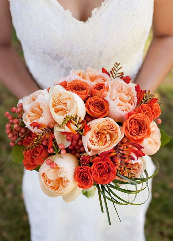 Orange fall bouquet with Juliet garden roses.