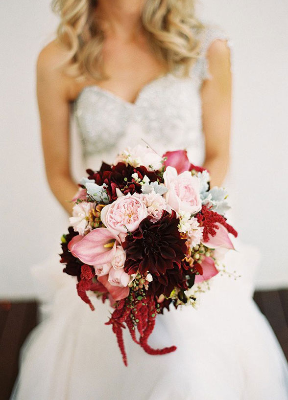 A textured bouquet of pink garden roses, burgundy amaranthus and dusty miller combine for a visually dynamic display.