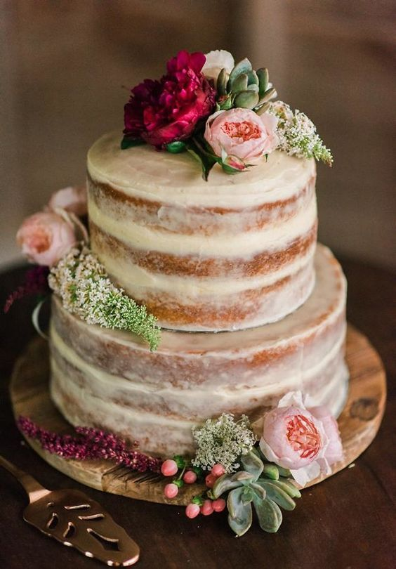 Rustic and effortlessly chic with minimal icing. Topped with fresh flowers makes it a lovely combo that's pretty and edible!
