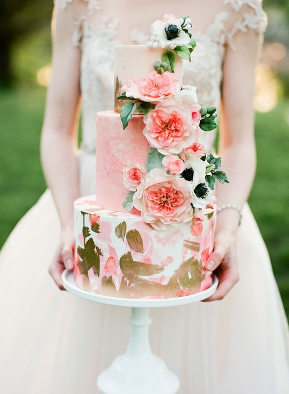 Super cool artsy wedding cake with English roses.