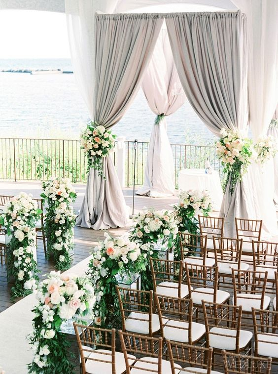 Love this lake side aisle and arbor! Do I spot some Juliet roses?