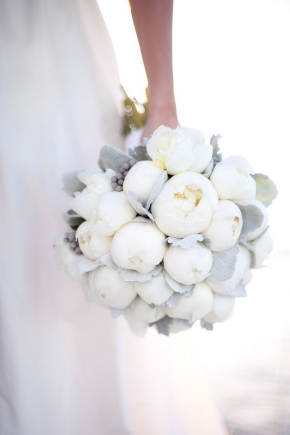 Stunning white wedding bouquet with peonies.