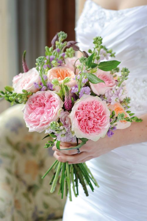 Keira, Miranda and Juliet roses are combined in this bridal bouquet. Miranda is a pink cottage garden style rose with green-streaked outer petals. And the Juliet rose is a soft peach in color.