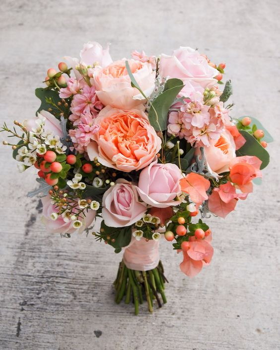 David Austin Juliet roses, bougainvillea and wax flowers incorporated in this beautiful bouquet.