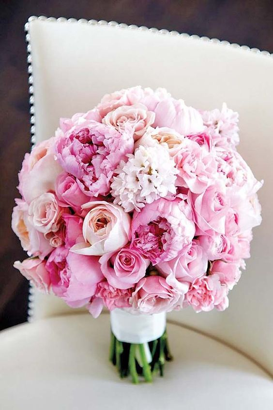 Soft pink wedding bouquet with pink peonies and blushy Juliet roses.