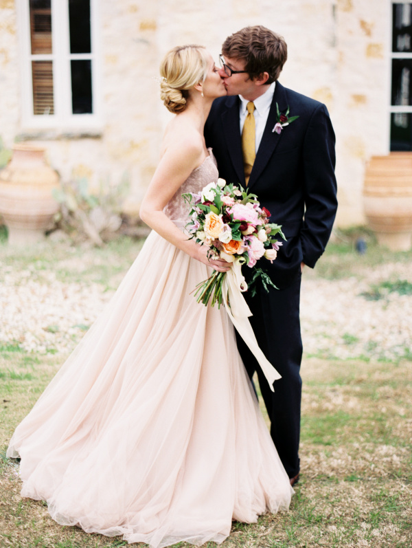 Stunning pink wedding dress with lovely florals.