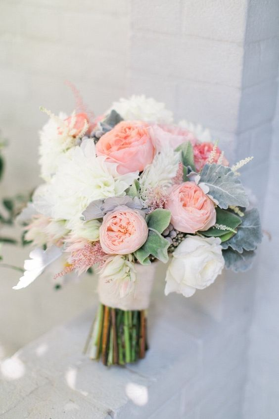 A coral wedding theme goes extremely well with a beachy-vibe. This bouquet with Juliet roses fits perfectly into that theme.
