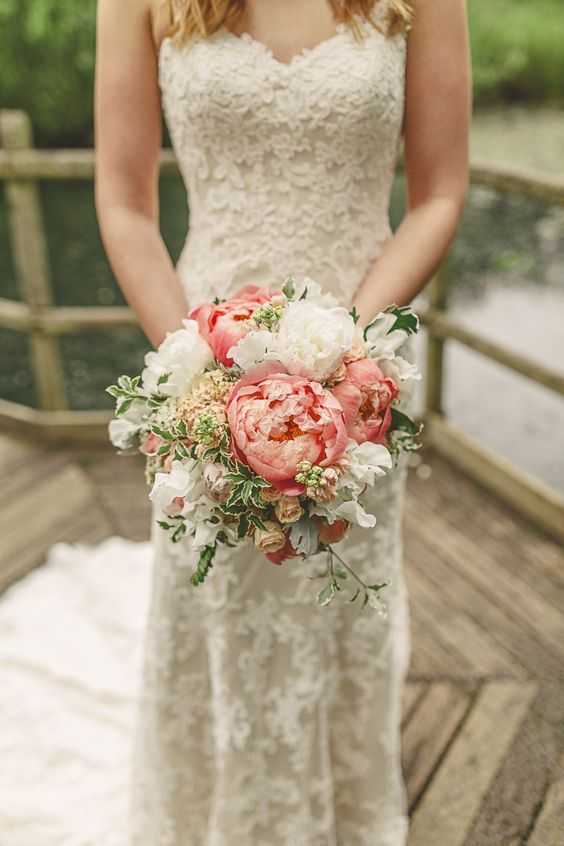 Romantic strapless lace gown and gorgeous coral peonies.
