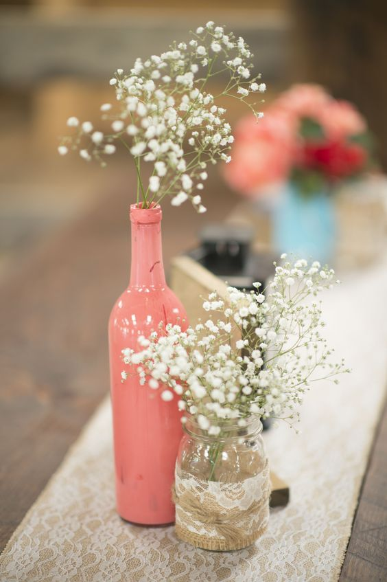 A rustic chic coral wedding theme with gypsophila.