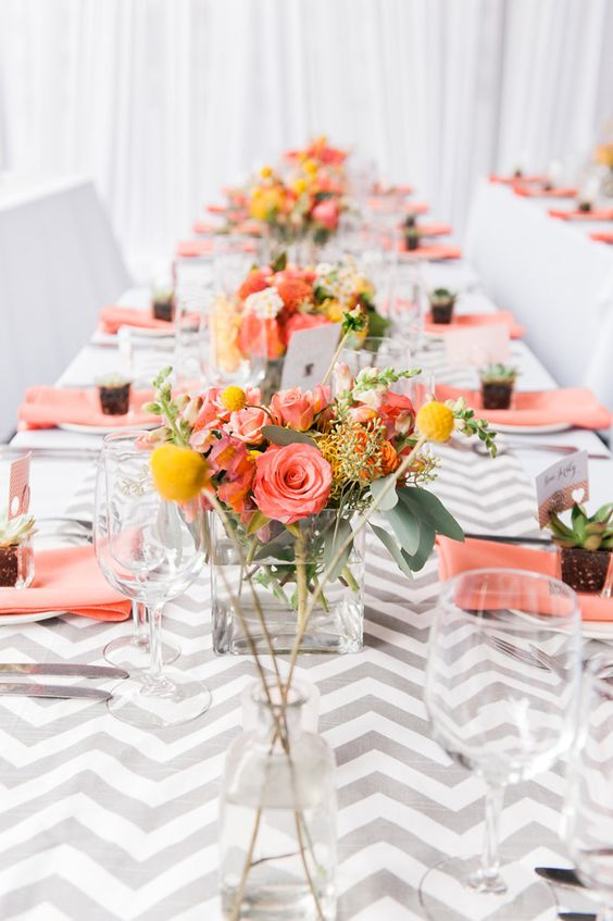Coral and yellow on a basic grey-white table setting.