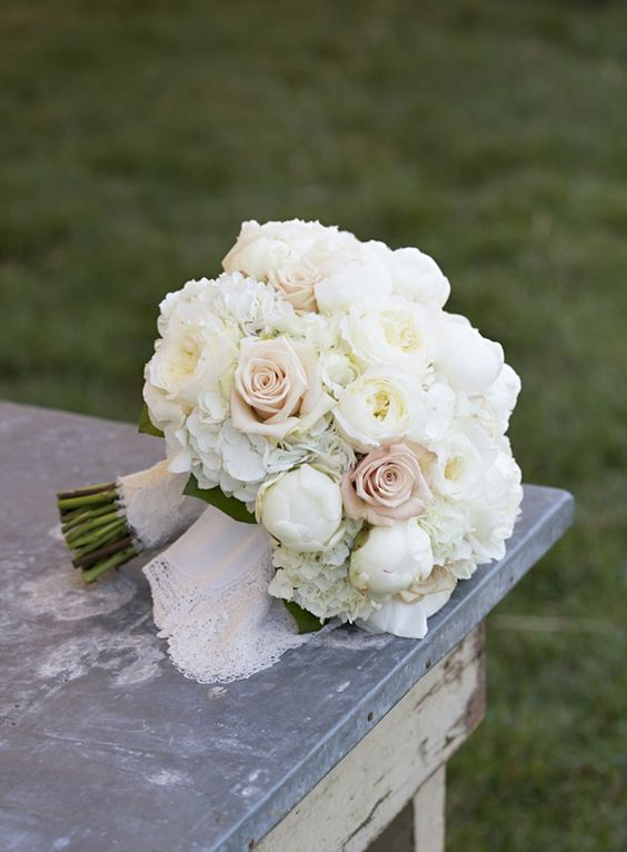Superbe Crisp And Classis With Ivory Patience Roses, White Peonies, White Hydrangea  And Sahara Roses