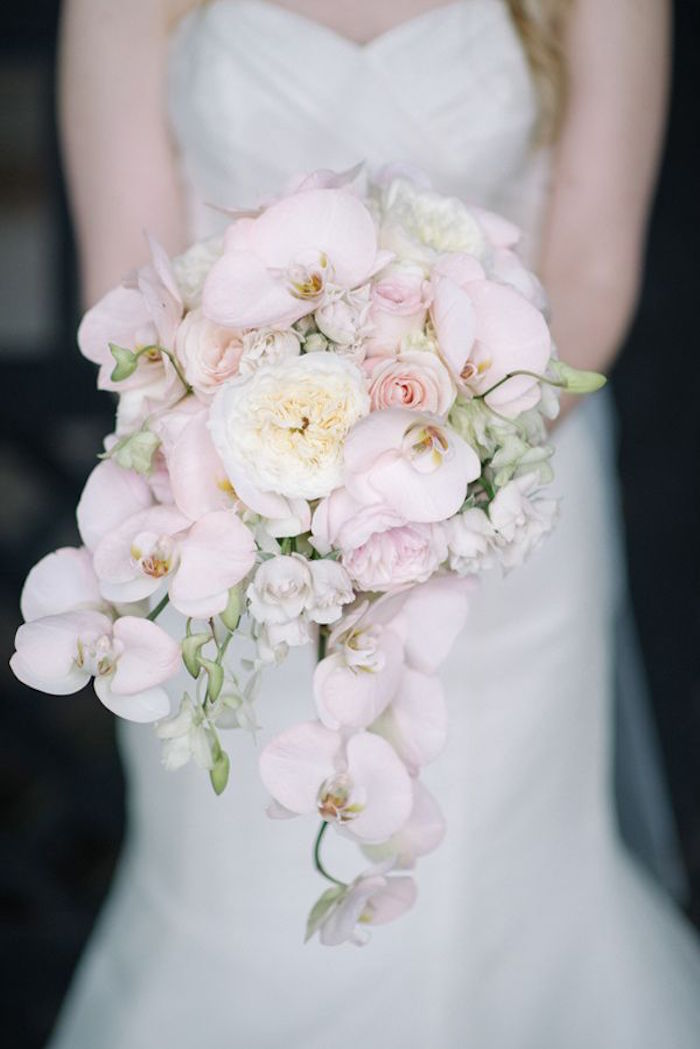 A cascading bouquet of cream hydrangeas and Patience roses.