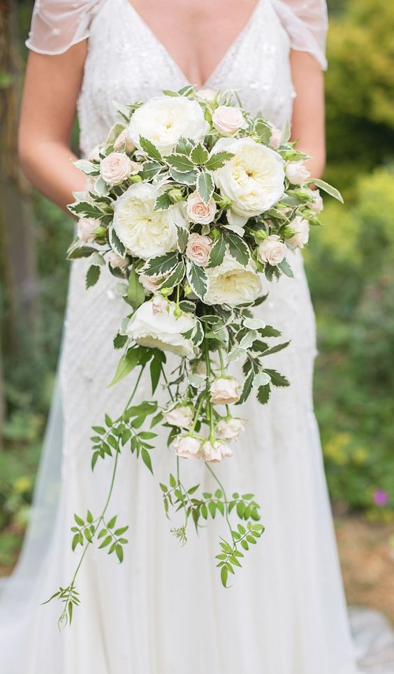 A cascading bouquet with David Austin Patience roses for a romantic peach & grey wedding.