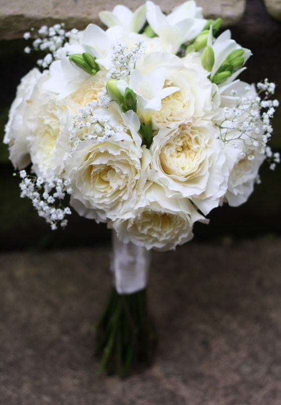 All white wedding bouquet with Patience roses and gypsophila.