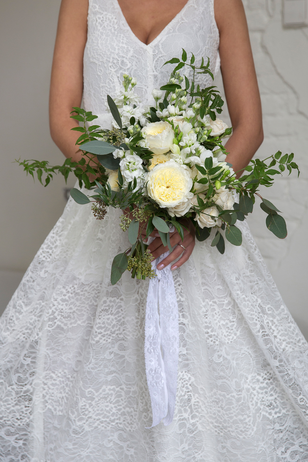 In this bouquet, the highly desirable wedding rose Patience is combined with Snow Ballet roses and lots of foliage for a natural, garden look.