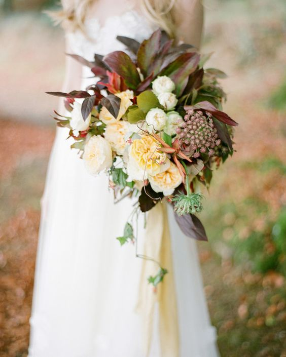 This bouquet includes 'Beatrice' and 'Patience' garden roses, chocolate Queen Anne's lace, fall foliage, and wild vines. Great choice for a bohemian wedding.