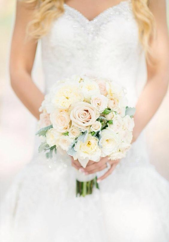 Beautiful wedding bouquet in champagne and blush.